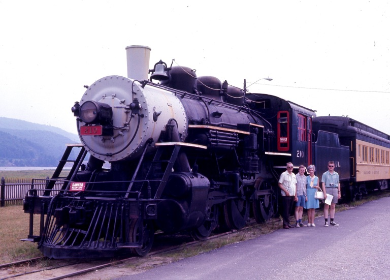 Dad, Ken, Mum, Rick beside N & St. L RR #210, Steamtown, Bellows Falls, Vermont